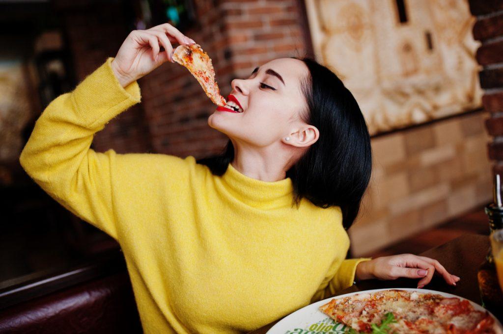 Girl eating pizza 1